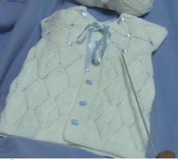 üçgen dilimli robalı bebek yelek modeli